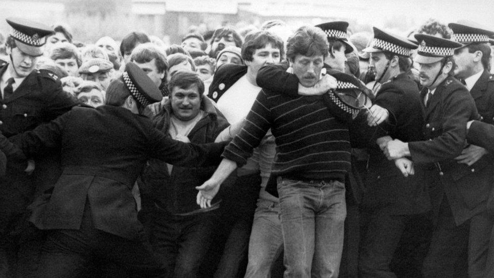Police restrain picketers outside a pit during the miners' strike in the 1980s