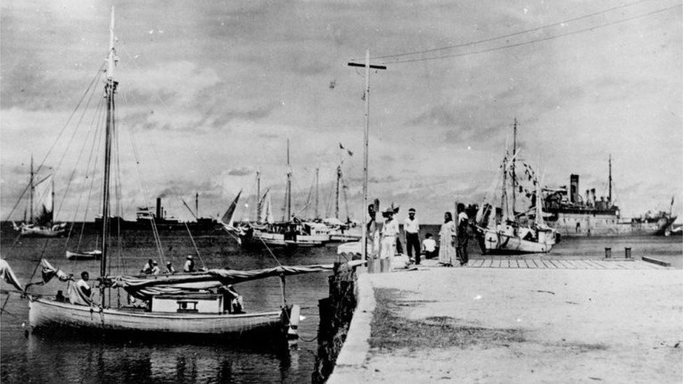 Pier on Jaluit Atoll with a group of people