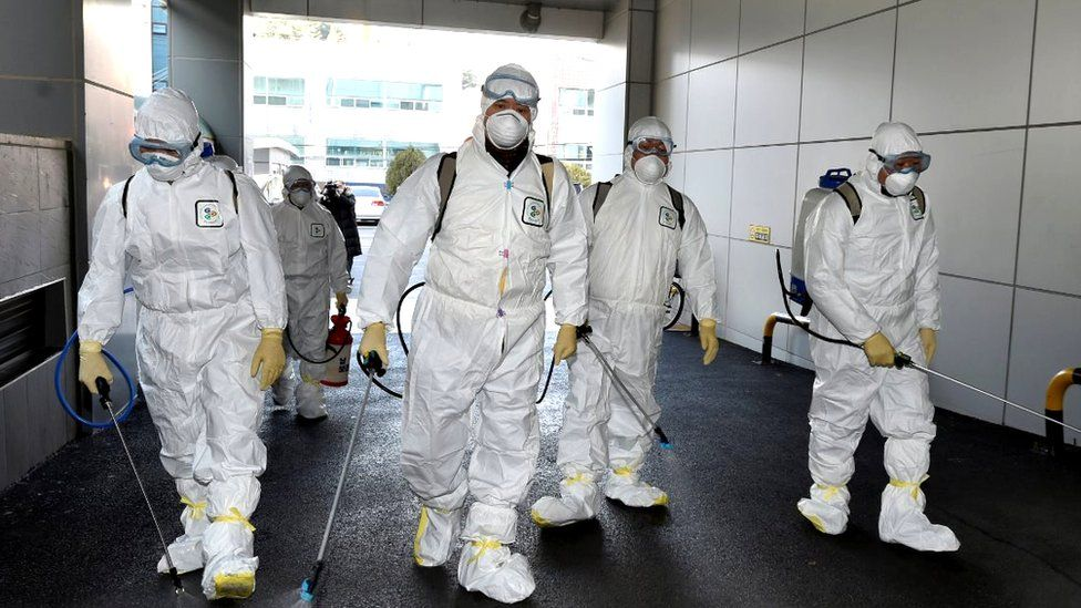 Health workers disinfecting a street