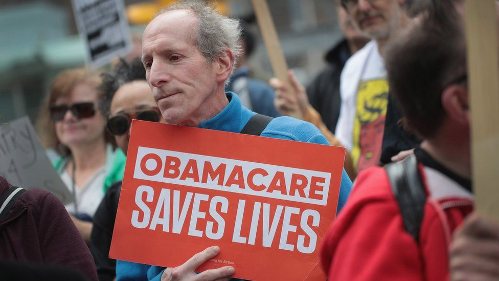 Demonstrators gather near Trump Tower to celebrate the defeat of President Donald Trump's revision of the Affordable Care Act (ACA) on March 24, 2017 in Chicago, Illinois