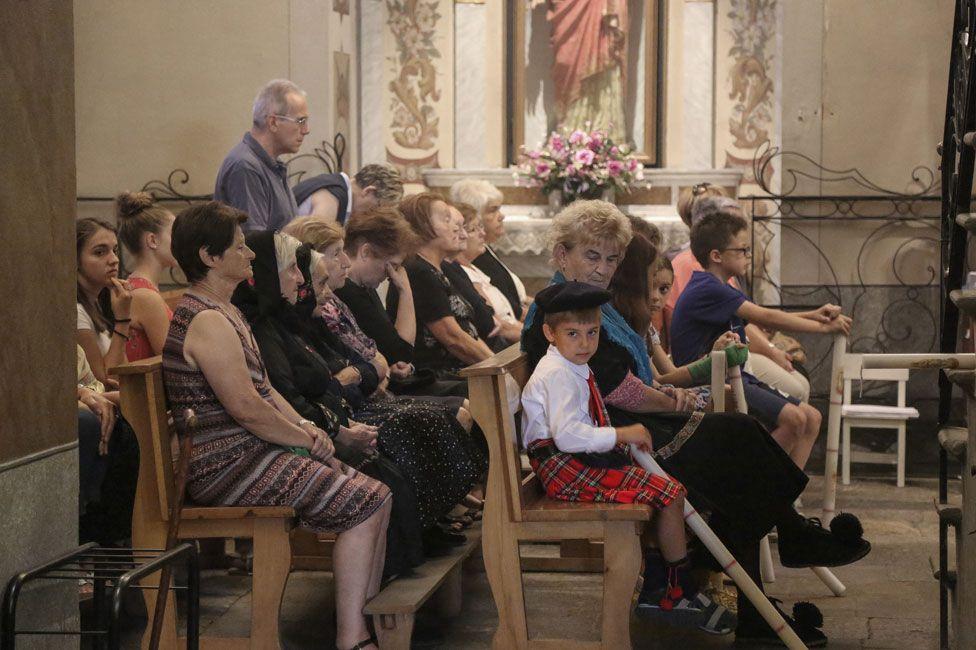 Boy wearing tartan in church