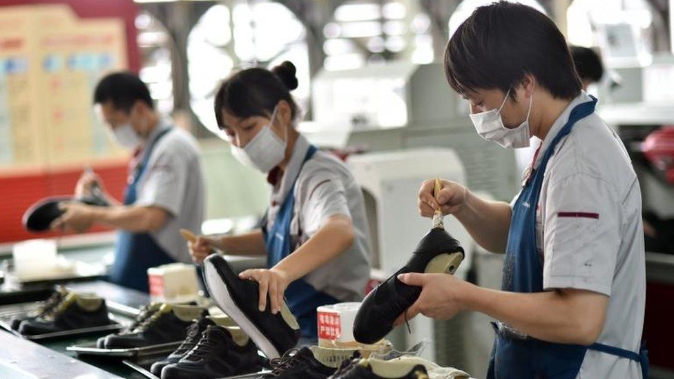 Workers in a shoe factory in China