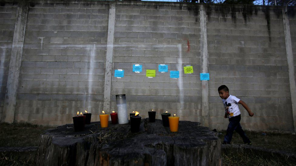 Candles are lit for victims after a fire broke at the Virgen de Asuncion home in San Jose Pinula on the outskirts of Guatemala City, March 8, 201