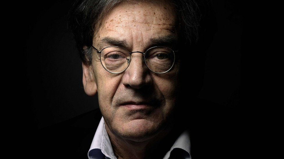 French writer and philosopher Alain Finkielkraut poses for a photograph at his home in Paris, 16 June 2015
