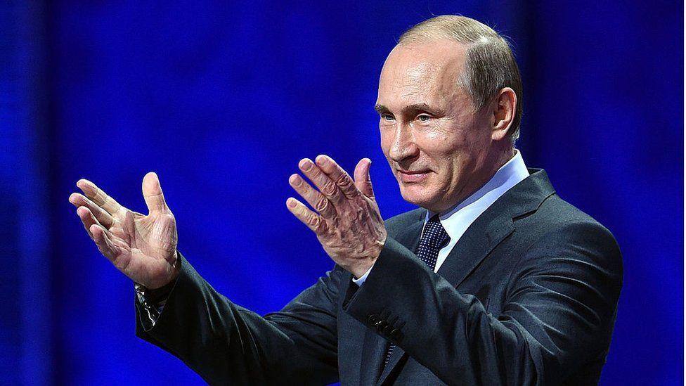 Vladimir Putin gestures