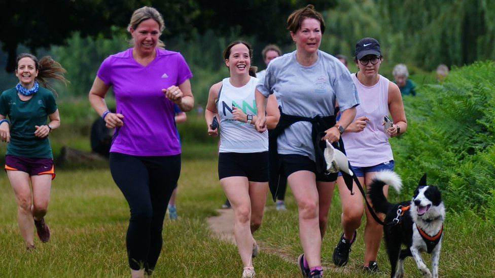 A dog joined runners at Bushy Park