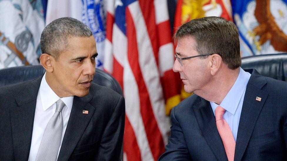 Barack Obama and Ashton Carter speaking during a meeting