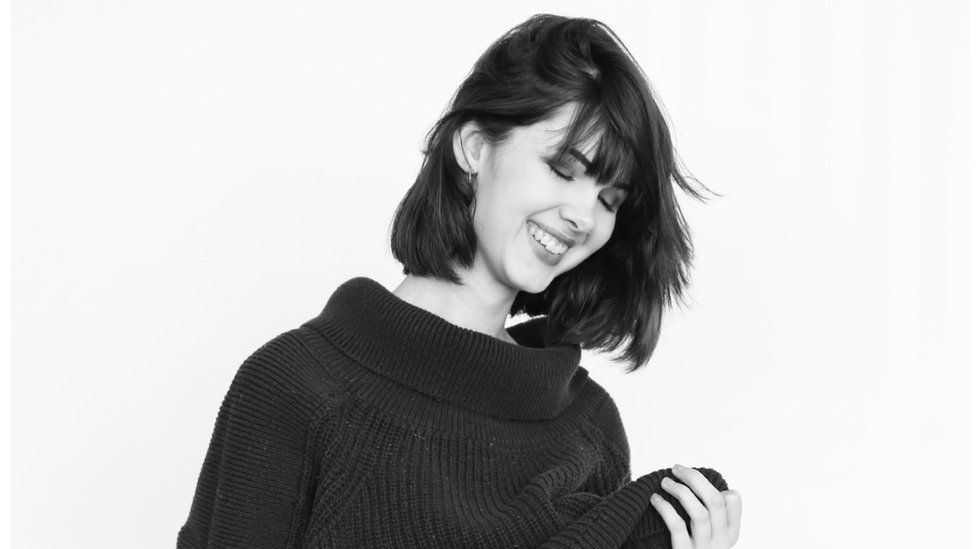 Black and white image of Bianca Devins