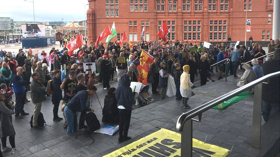 Protesters on the steps of the Senedd in Cardiff Bay