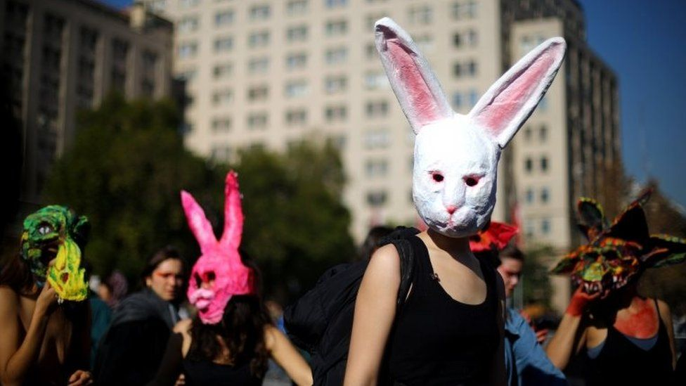 Demonstrators wear masks during a march demanding an end to sexism and gender violence in Santiago, Chile June 6, 2018.