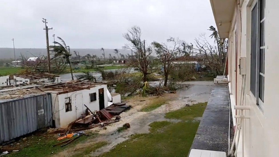 Debris, trees and building damage in Tinian
