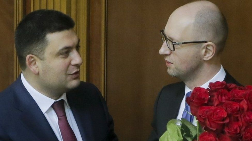 Prime Minister Arseniy Yatsenyuk, (right) and Parliament Speaker Volodymyr Groysman celebrate after Mr Yatsenyuk was appointed prime minister during the opening first session of the Ukrainian parliament in Kiev (27 November 2014)
