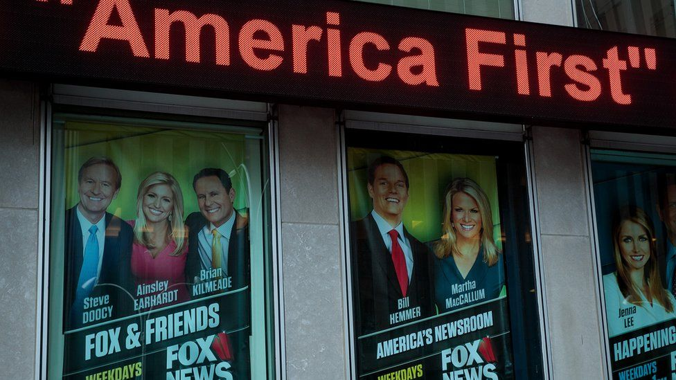 Posters are framed outside of the Fox News headquarters.