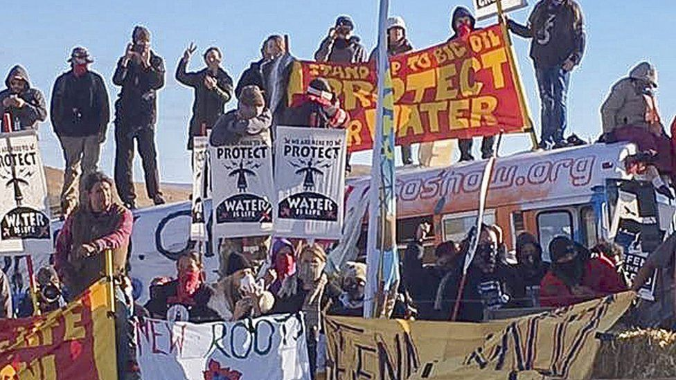 """A handout picture made available by the Morton County Sheriff""""s Department shows protesters holding placards during a demonstration against the North Dakota oil pipeline project, along the Dakota Access Pipeline construction site, in Morton County, North Dakota, USA, 27 October 2016."""
