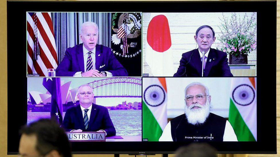 A monitor displaying a virtual meeting of the Quad members - Australia, India, Japan and the United States