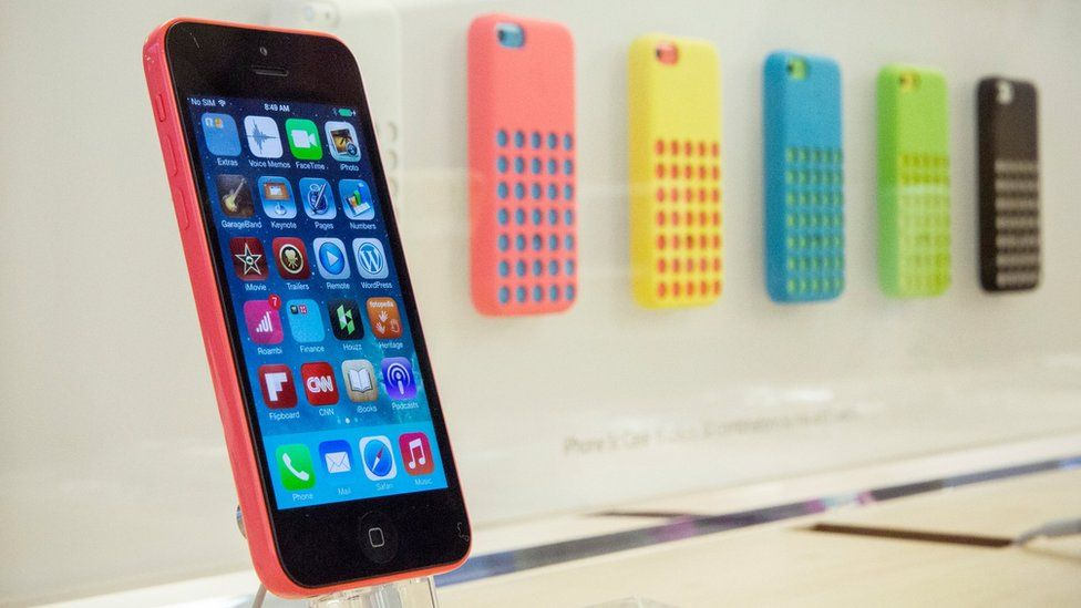 Different colour versions of the iPhone 5C with their coloured cases, September 2013