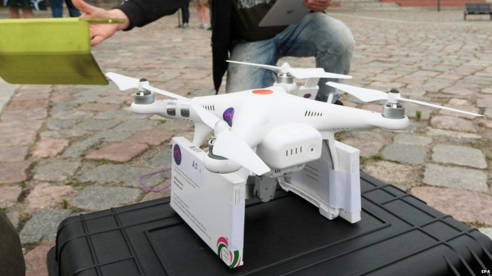 A drone fitted with packets of abortifacient pills is prepared for its flight to Slubice in Poland, in Frankfurt an der Oder, Germany, on Sunday