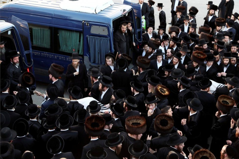 Ultra-Orthodox Jewish men gather at the funeral of Moshe Engerld and his brother Yehoshua