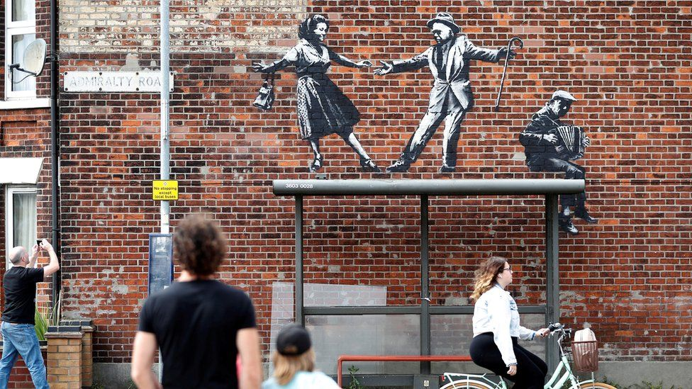 People stop to look at artwork believed to be created by Banksy in Great Yarmouth
