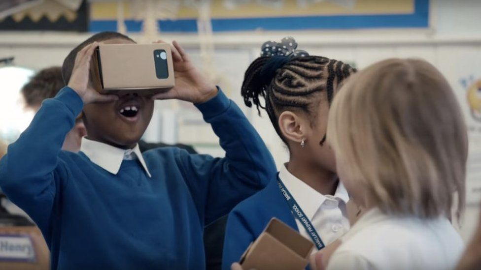 Boy wearing Google Cardboard