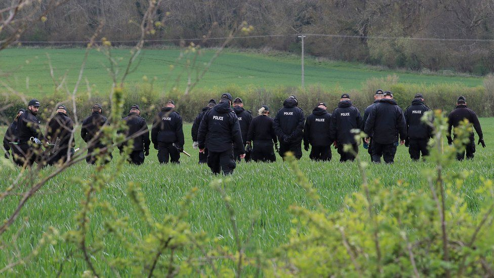 Police officers continue their search of fields close to the hamlet of Snowdown, near Aylesham
