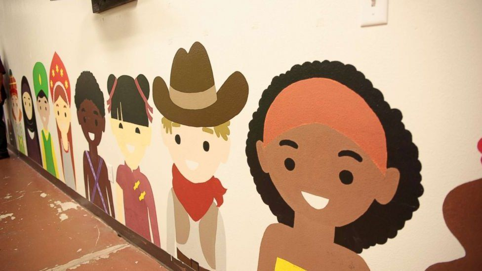 Murals adorn the walls of the former Walmart