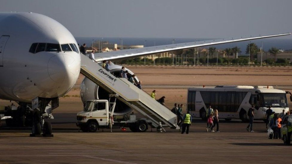 Tourists disembark a Egypt Air plane in Sharm el-Sheikh