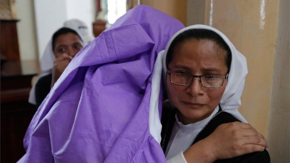 A woman afraid of pro-government Sandinista youths embraces a nun as she takes shelter at the San Sebastian Basilica in Diriamba, Nicaragua, on July 9, 2018.