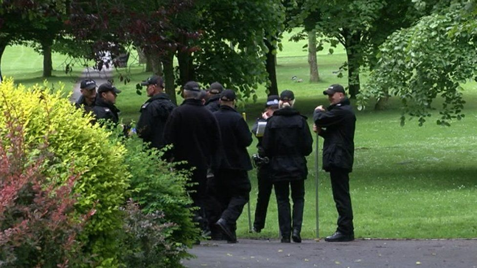 Police searching the undergrowth