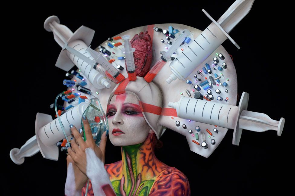 A model, painted by bodypainting artist Alex Hansen from Brasil, poses for a picture
