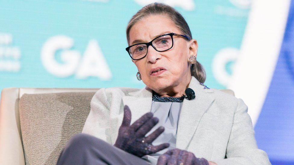 Ruth Bader Ginsburg in her trademark lace gloves