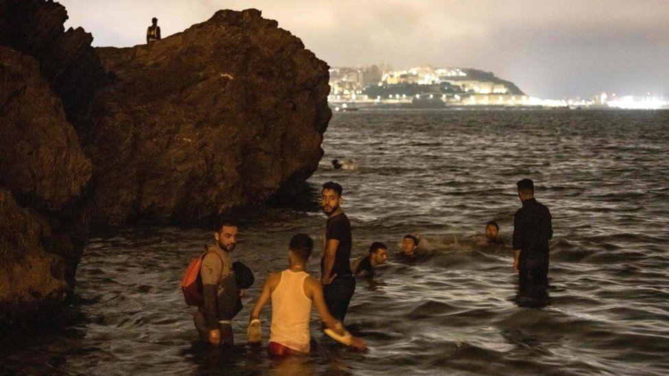 Migrants in water at Fnideq, 18 May 21