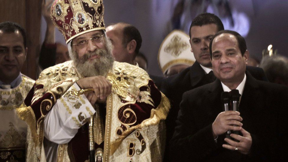 The Coptic Pope in brocaded robes and a mitre, alongside President Sisi in a bow tie and tails