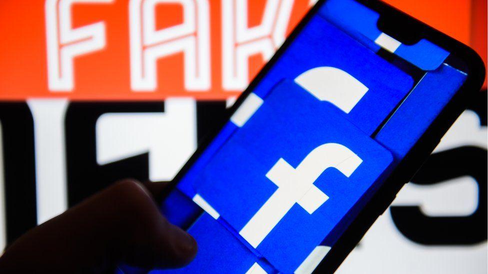 Facebook logo against Fake News background
