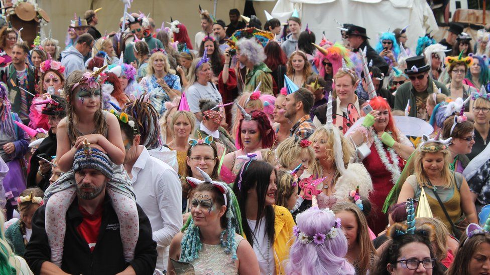 Crowd wearing unicorn horns