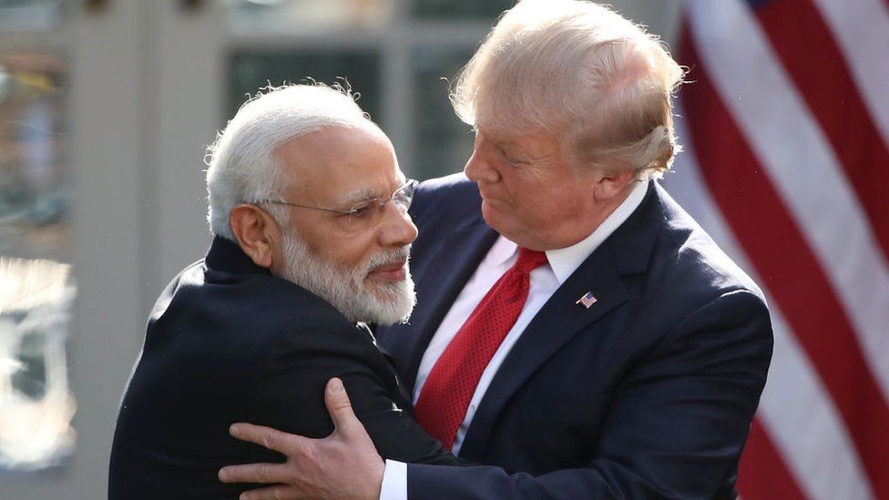 President Donald Trump (R) and Indian Prime Minister Narendra Modi embrace outside the White House in 2017.