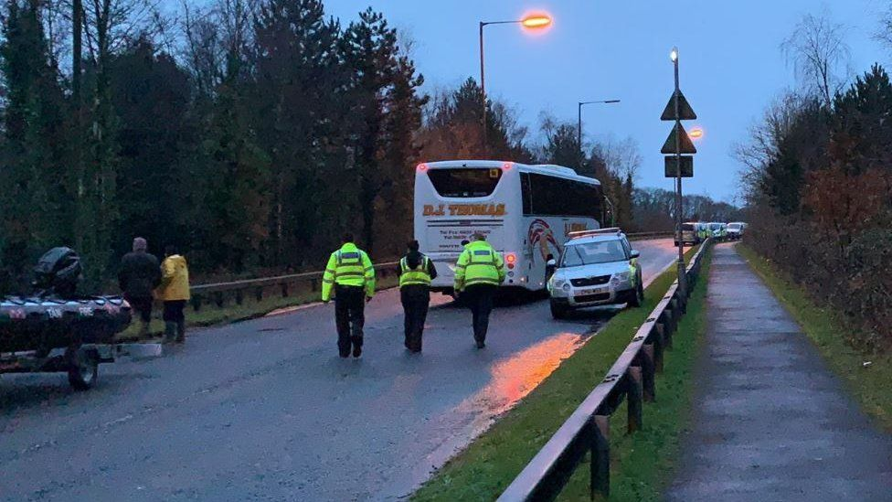 Bus evacuating residents of Tonna near Neath