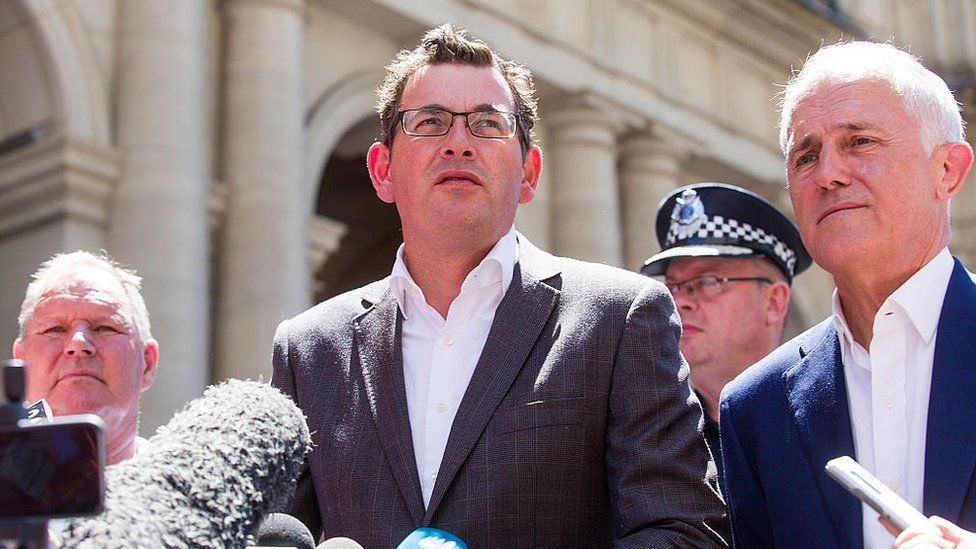 Premier Daniel Andrews speaks to the media on Sunday, flanked by Lord Mayor Robert Doyle and Prime Minister Malcolm Turnbull