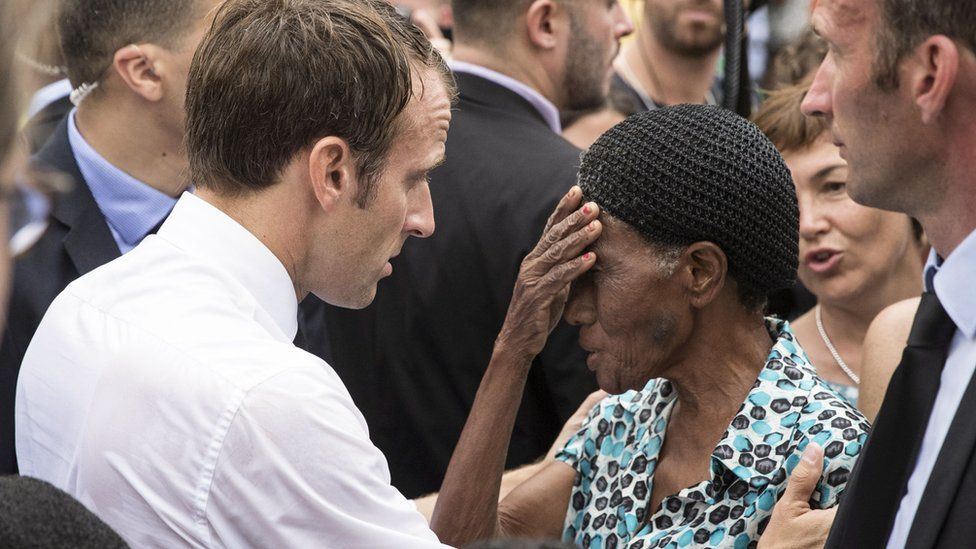 French President Emmanuel Macron speaks with a resident on the French Caribbean island of Saint-Martin, 29 September 2018