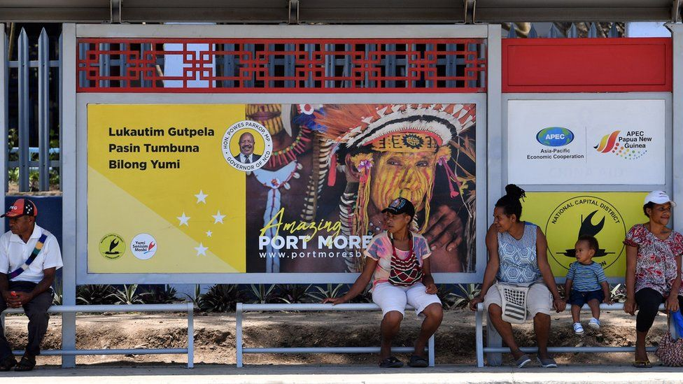 This picture taken on November 13, 2018 shows residents waiting at a bus stop donated by China in downtown Port Moresby, ahead of the Asia-Pacific Economic Cooperation (APEC) summi