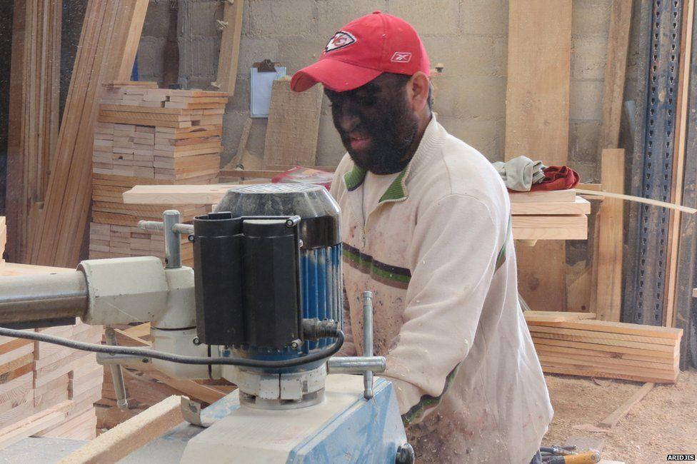 Aceves working in a lumber yard