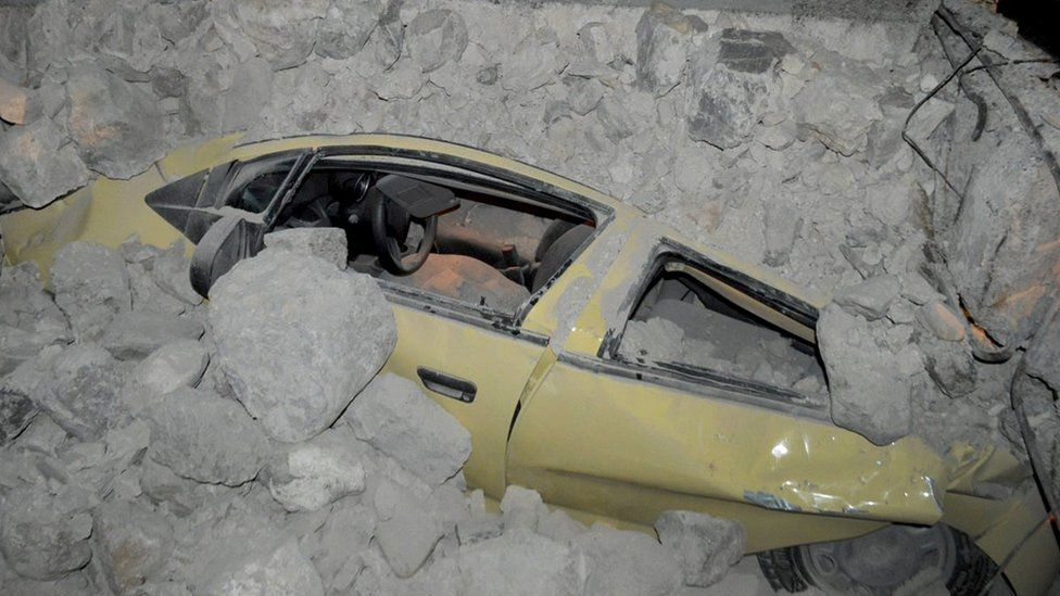 A car crushed by rubble after the earthquake in Kos