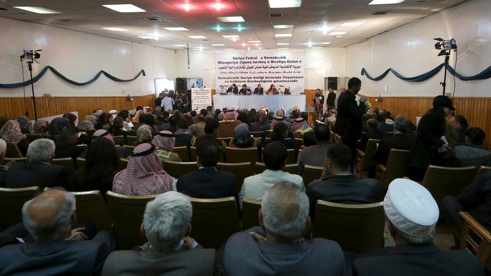 Syrian Kurdish representatives attend a conference in Rmeilan on 16 March 2016