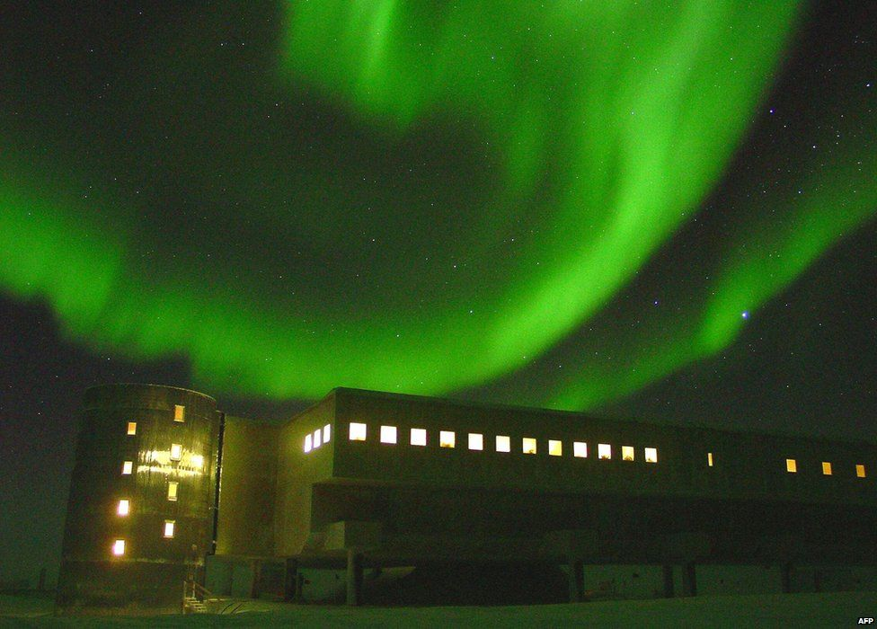 The southern lights, over the geodesic dome at the National Science Foundation's Amundsen-Scott South Pole station, 22 May 2002