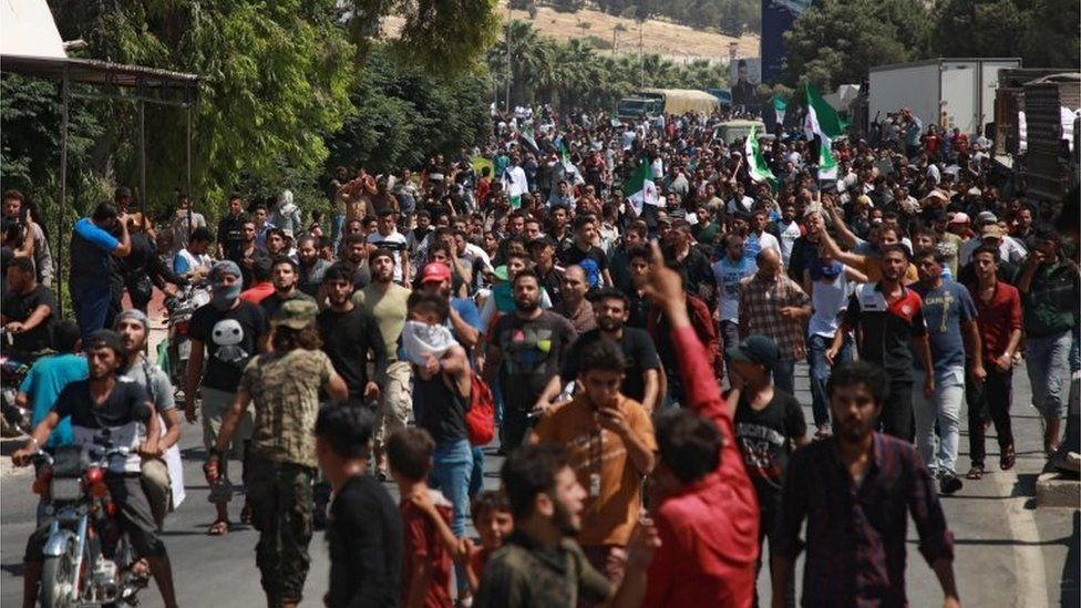 Syrians from the country's northern countryside demonstrate by the Bab al-Hawa crossing between Turkey and Syria's north-western Idlib province