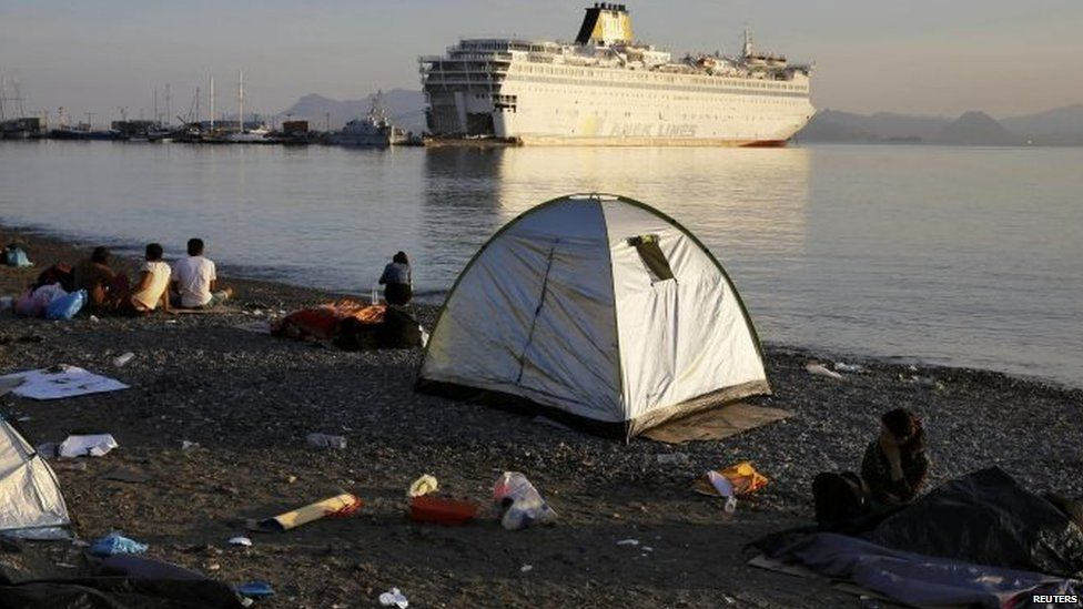 Syrian refugees camp on a Kos beach near the port where the ferry Eleftherios Venizelos is docked 15/08/2015.