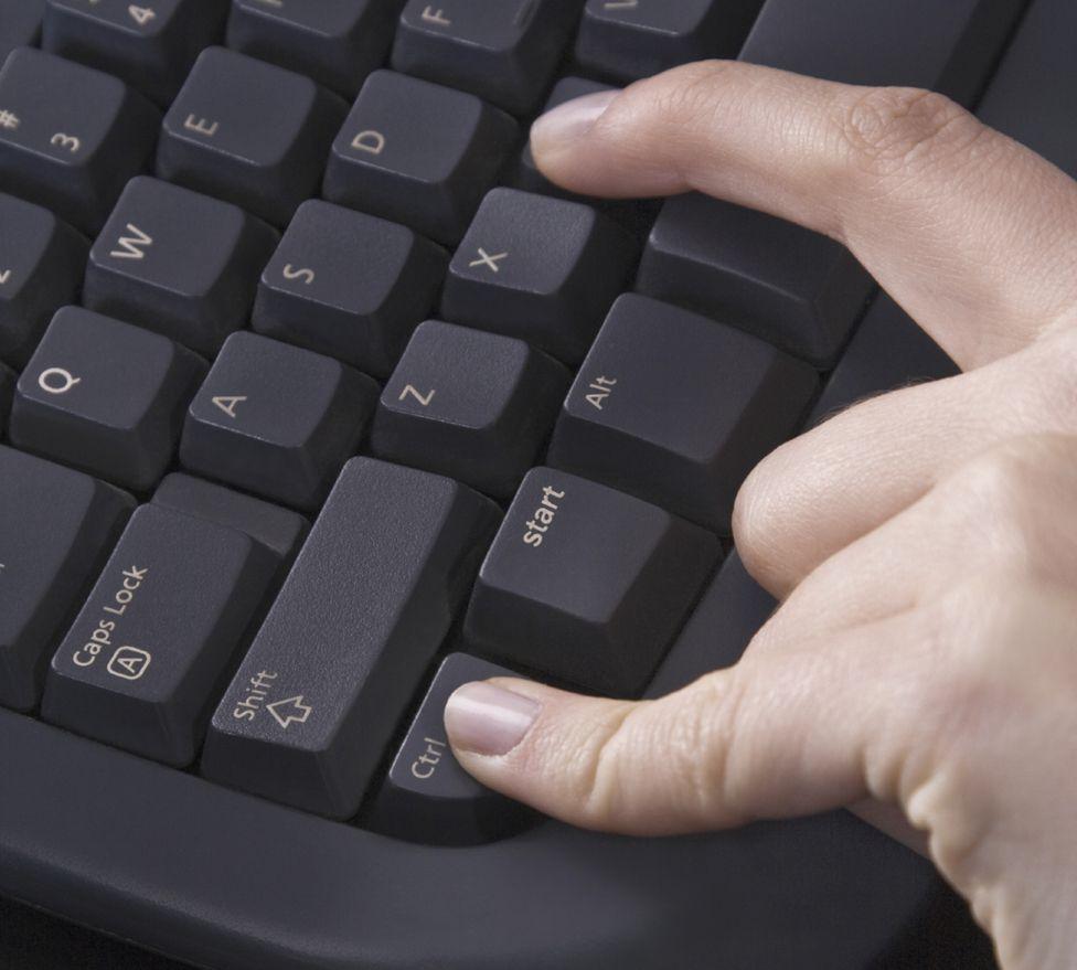 Hand on keyboard pressing Ctrl C