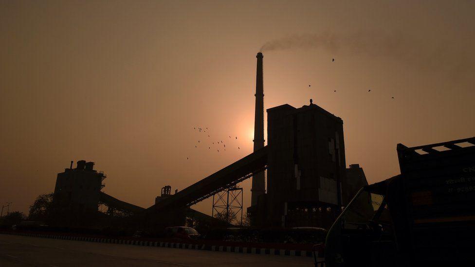 A factory emits smoke in New Delhi, 19 February 2015