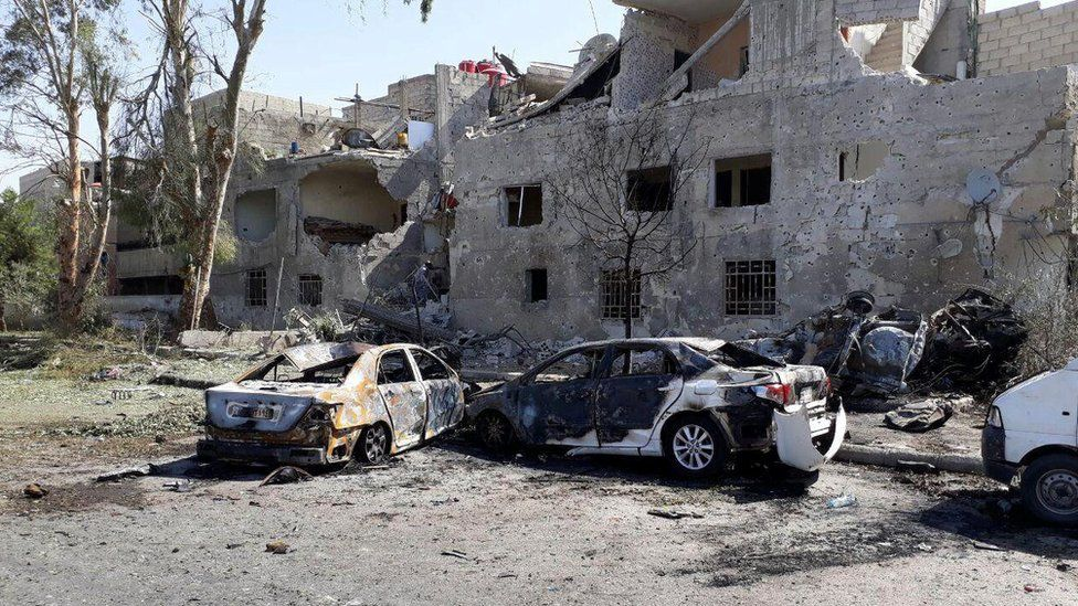 Damaged cars are seen at one of the blast sites in Damascus in this handout picture posted on SANA on July 2, 2017