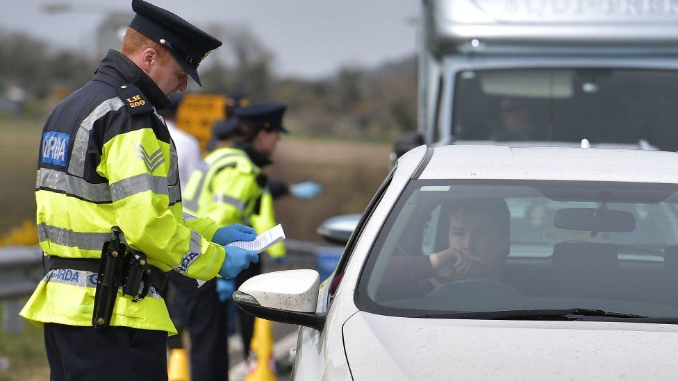 Irish police officers check drivers and cars during the coronavirus outbreak